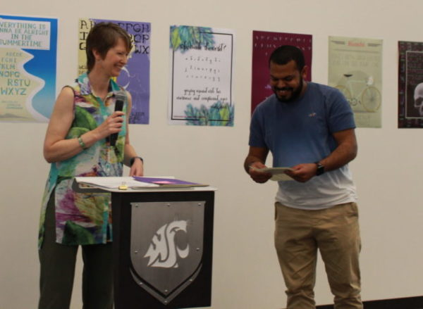 Rebecca Goodrich hands Sulaiman Ambusaidi his award for Established Scholar