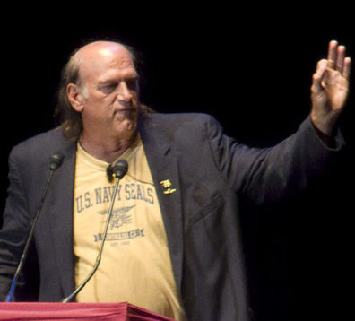 Jesse Ventura speaking behind podium