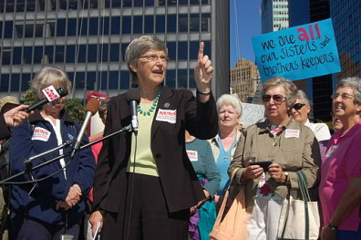 Sister Simone Campbell speaks in front of a crowd
