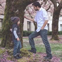Image: Man and son talk outside by a tree
