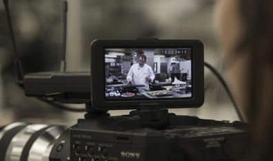 Camera view of Chef Jamie Callison preparing a meal.