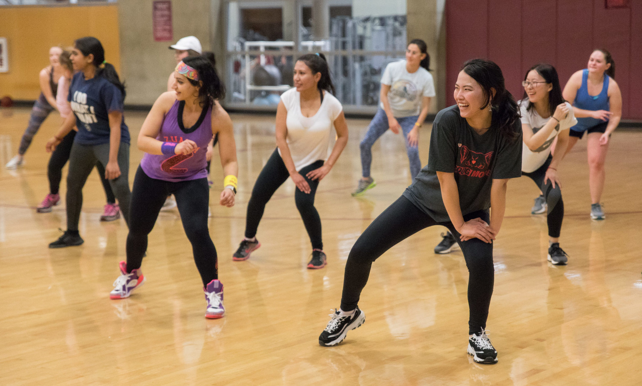 Photo of students dancing at a Zumba class