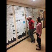 2 people read the history research posters.