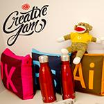 adobe creative jam monkey, pillows, water bottles