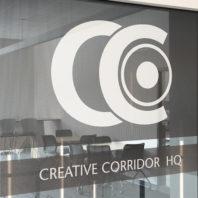 Photo: Creative Corridor logo on interior window at Creative Corridor headquarters.