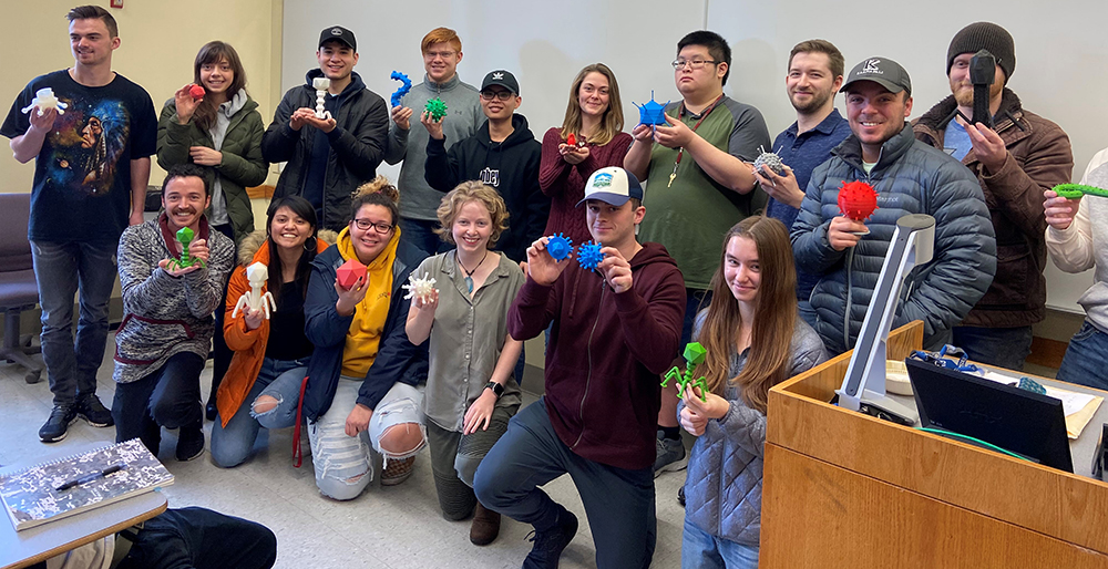 Photo: Students in General Virology class hold up their virus models created in the Spark Innovation Hub.