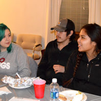 Students visit at a community dinner