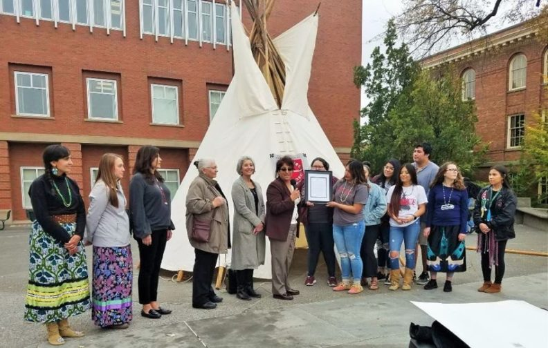 Group in front of tipi on Terrell Mall