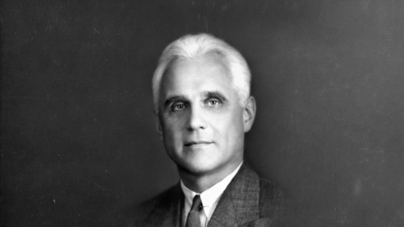 A black and white headshot of Wilson M. Compton