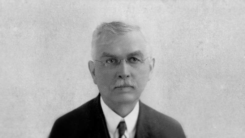 A black and white head shot of John W. Heston