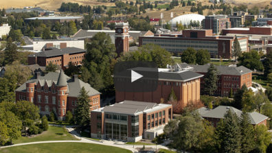 Aerial view of campus, which has a play button to reference this is a link to YouTube