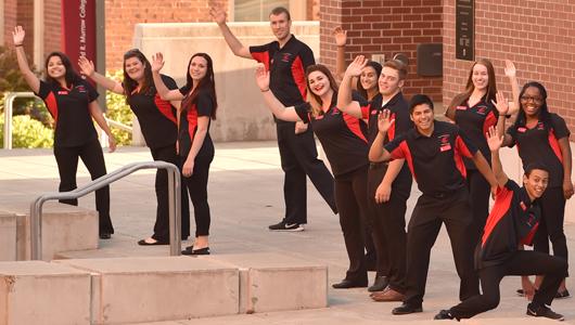 Student ambassadors waving