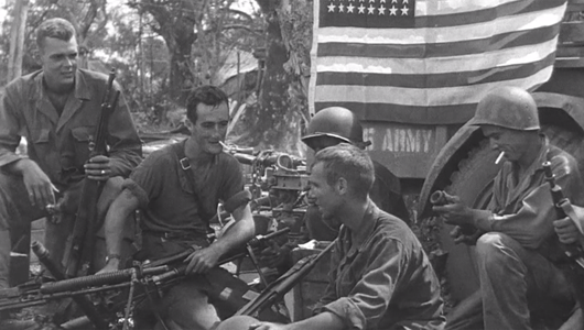 WWII archive photo of 161st Infantry soldiers relaxing