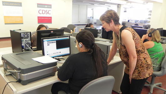 computer workstation with two women