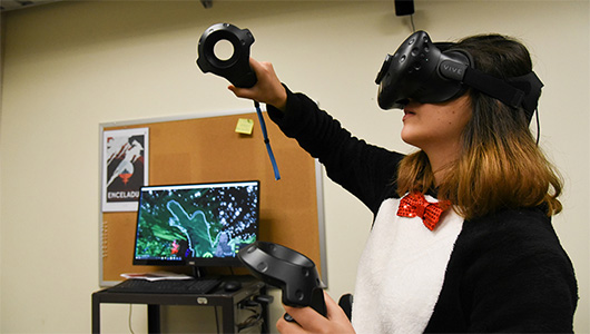 Student Adriana Iturbe paints a tree in an an environment created in virtual reality