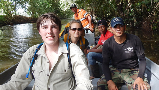 Travis King travels through a Costa Rican swamp at Tortuguero National Park in 2014, with a team from Panthera and local guides.