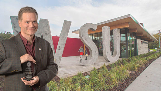 Tom Busch standing in front of the Brelsford WSU Visitor Center.