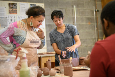 Io working with students in the sculpture studio