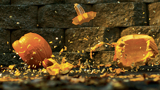 A pumpkin exploding as it collides with the earth