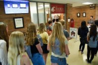Students gathered in a hallway during a campus tour.
