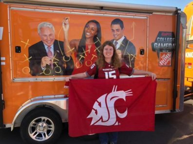 student with WSU flag and ESPN bus