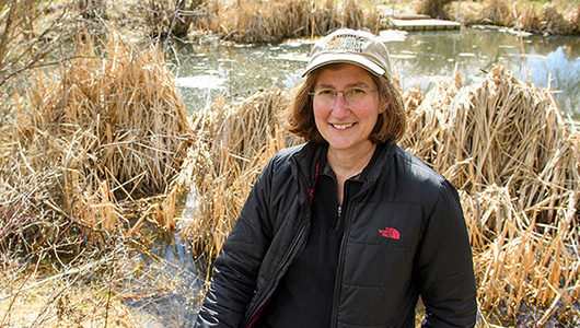 Caren Goldberg near an Idaho pond.