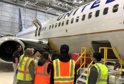 Murray at a United Airlines San Francisco facility with data analytics seniors