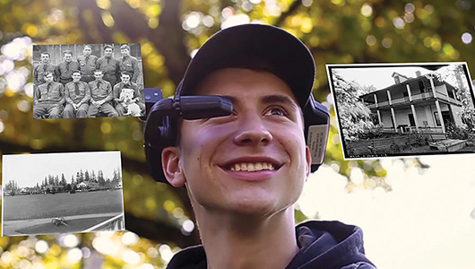 A student wearing a headset; black and white photos appear before his face.