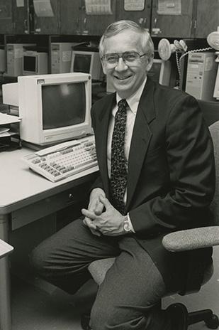 Don Dillman sitting at a desk.