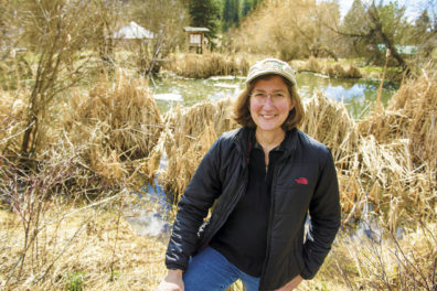 researcher near a pond