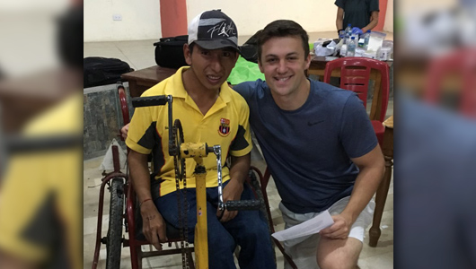 Charles Toye next to Ecuadorian in a wheelchair.