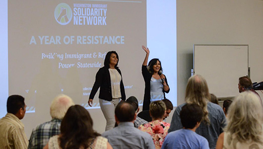 Brenda Rodriguez and colleague Monserrat Padilla speaking to an audience.
