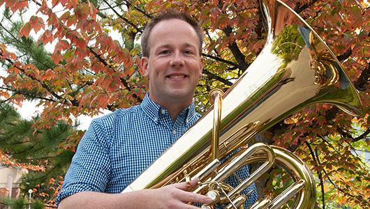 Chris Dickey holding a tuba