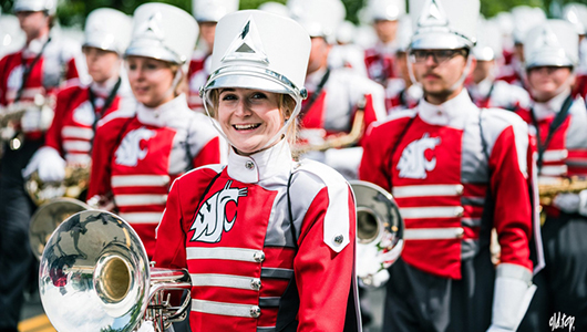 Smiling member of the Cougar Marching Band.