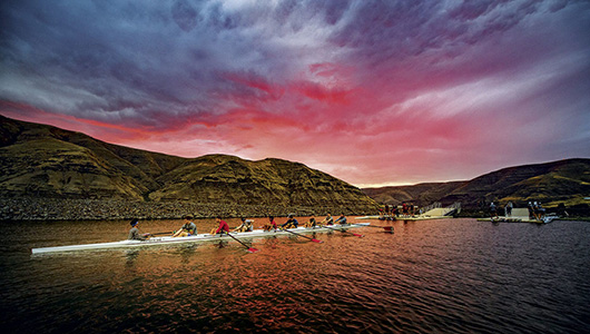 WSU rowers in action under a colorful sunset.
