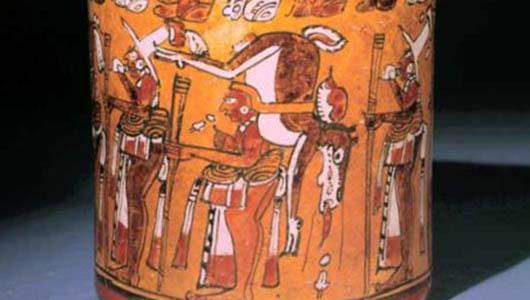 A detail of a classic Mayan polychrome vessel depicting a deer hunt.