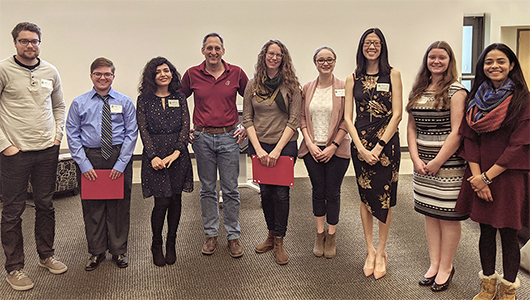 Three minute thesis contestants with Dean Jockers.
