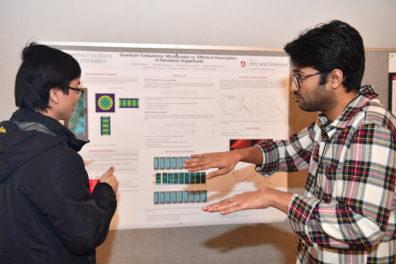 A researcher explaining a scientific poster.