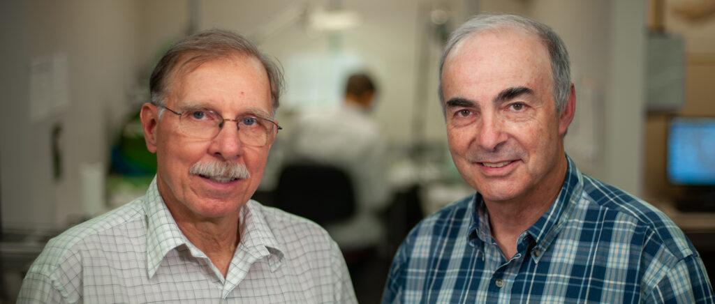 portrait of two older men, side by side.
