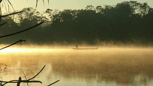 A Tsimane villager crossing on Maniqui river early in the morning.