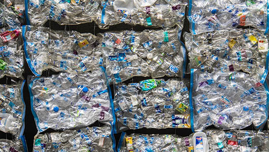 Plastic waste in shrink wrapped bags.