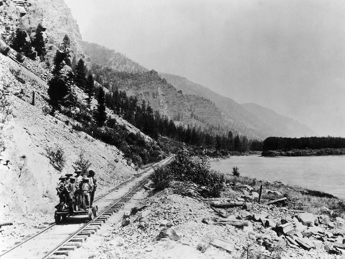 Historic photo of railway and lake.