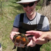 Jesse showing off a turtle at a local pond.
