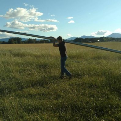 The author's brother moves an irrigation pipe in the Willamette Valley. Making management decisions amid multiple uncertainties is at the heart of what farmers do. Photo credit: Liz Allen