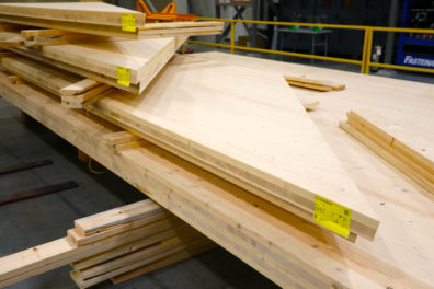 Stacked cross-laminated timber panels pre-cut with angles and joints