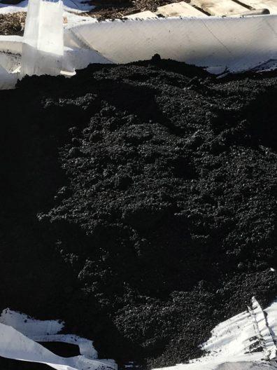 Bag full of biochar, a black gravelly material