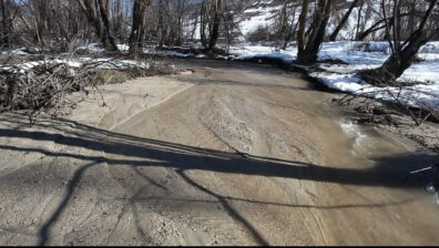 Water flowing along road, showing where sediments are being moved.