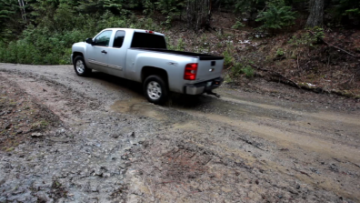 Truck driving through a muddy drivable dip