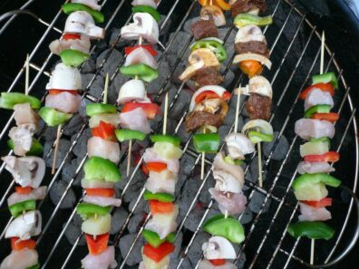Chicken and beef kebabs on a grill