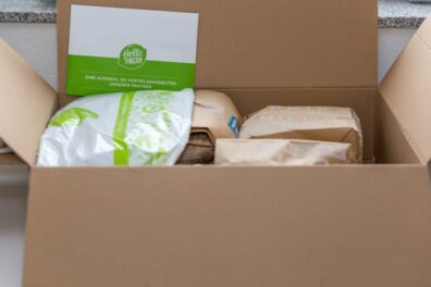 Open box showing small packets of wrapped foods, with the meal kit label